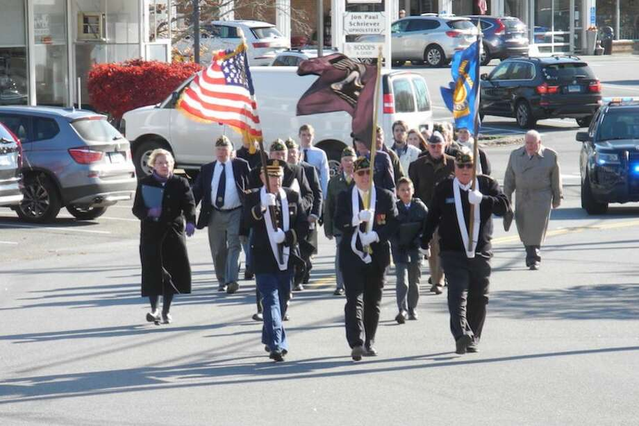 Wilton veterans march to the Veterans Memorial Green.