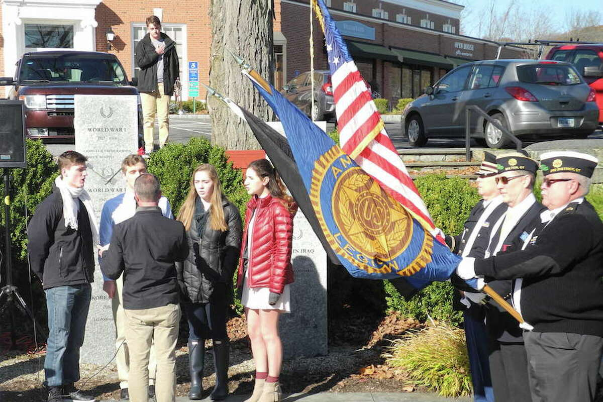 Wilton High School singers perform the National Anthem.