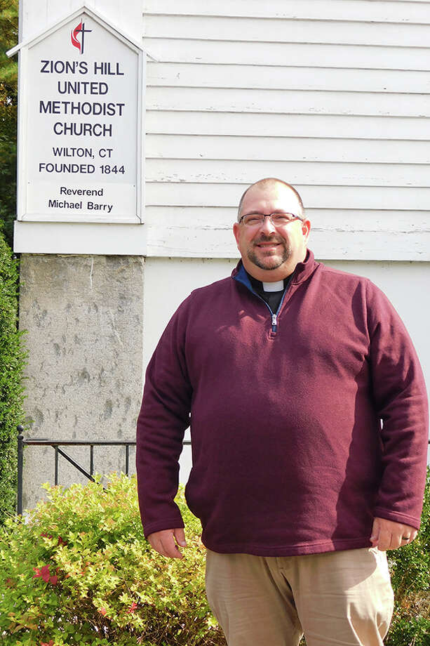 Zion's Hill United Methodist Church's new minister, the Rev. Michael Barry, outside the church at 470 Danbury Road. — Kendra Baker photo / NikonCoolpix