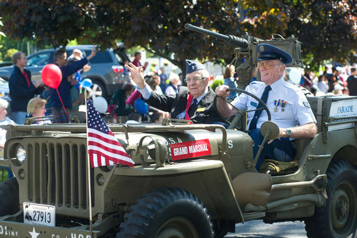 Air Force veteran Bing Ventres drives Grand Marshal Judd Mott in an Army jeep during the 2013 Memorial Day parade. - Bryan Haeffele photo