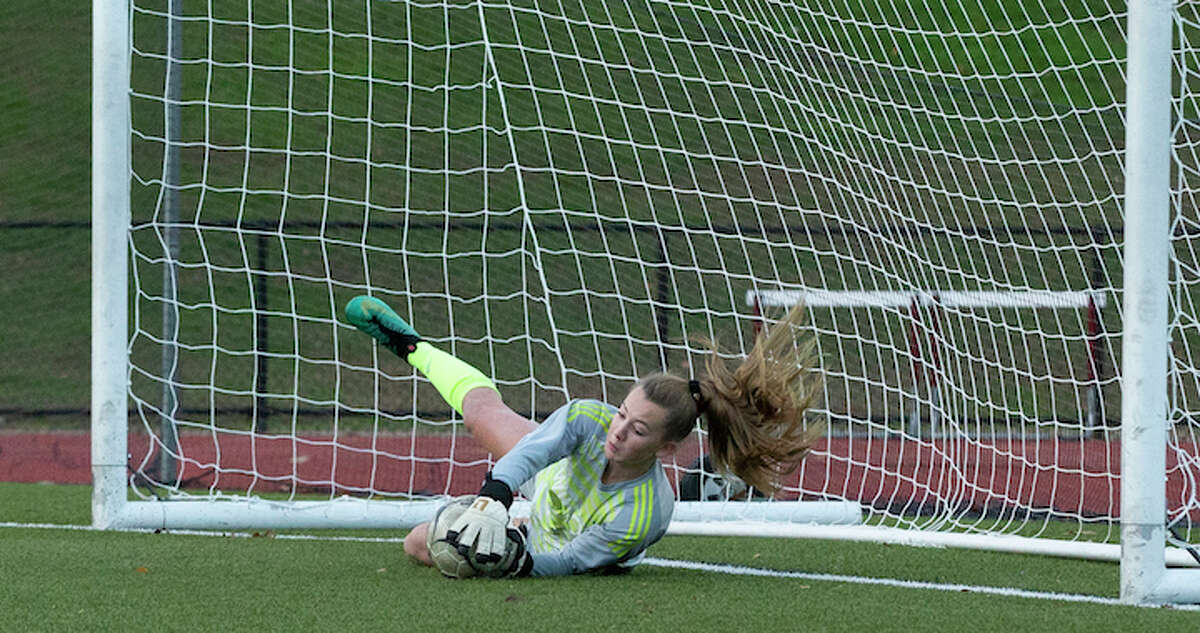 Freshman goalie Erynn Floyd secured Wilton's 2-1 upset win over St. Joseph with this save in the second round of penalty kicks. - GretchenMcMahonPhotography.com
