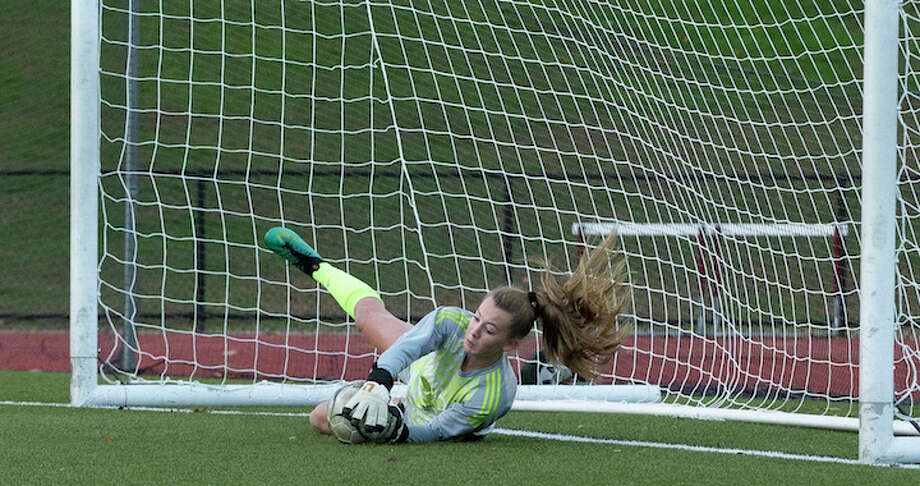 Freshman goalie Erynn Floyd secured Wilton's 2-1 upset win over St. Joseph with this save in the second round of penalty kicks. — GretchenMcMahonPhotography.com
