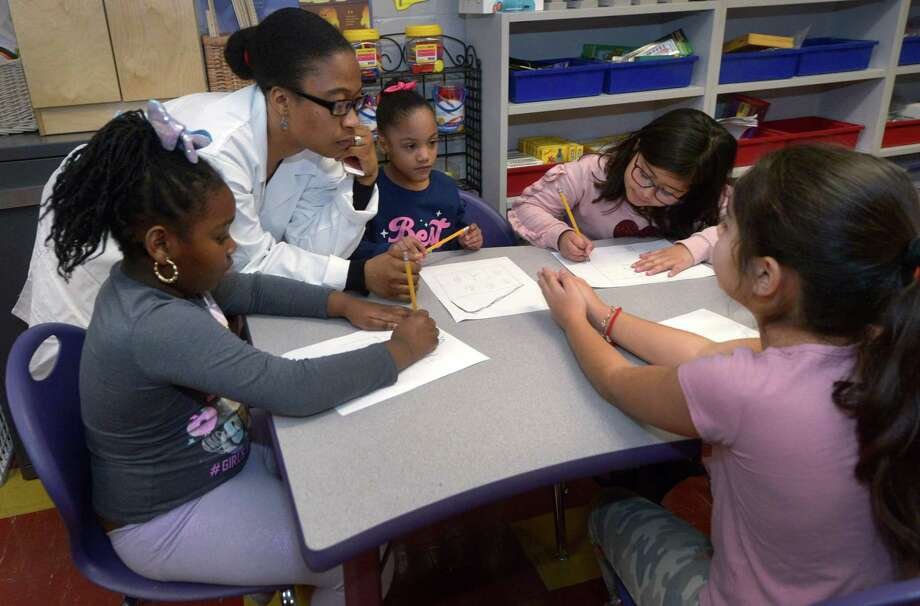 """A science teacher and her students at Tracey Elementary School , talk over their lesson on Wednesday January 16, 2019. The school will be getting an improved cafeteria to provide a more """"family-styled"""" atmosphere. Photo: Erik Trautmann / Hearst Connecticut Media / Norwalk Hour"""