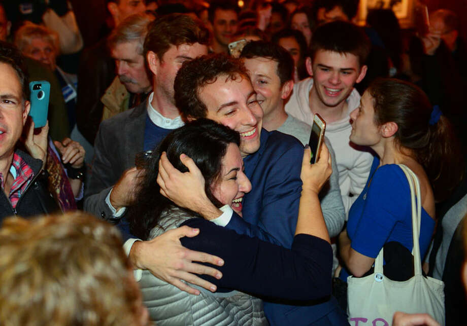 Democrat Will Haskell hugs a supporter after beating Republican incumbent Toni Boucher during a post election party at the Little Barn in Westport on Tuesday night. — Christian Abraham/Hearst Connecticut Media / Connecticut Post
