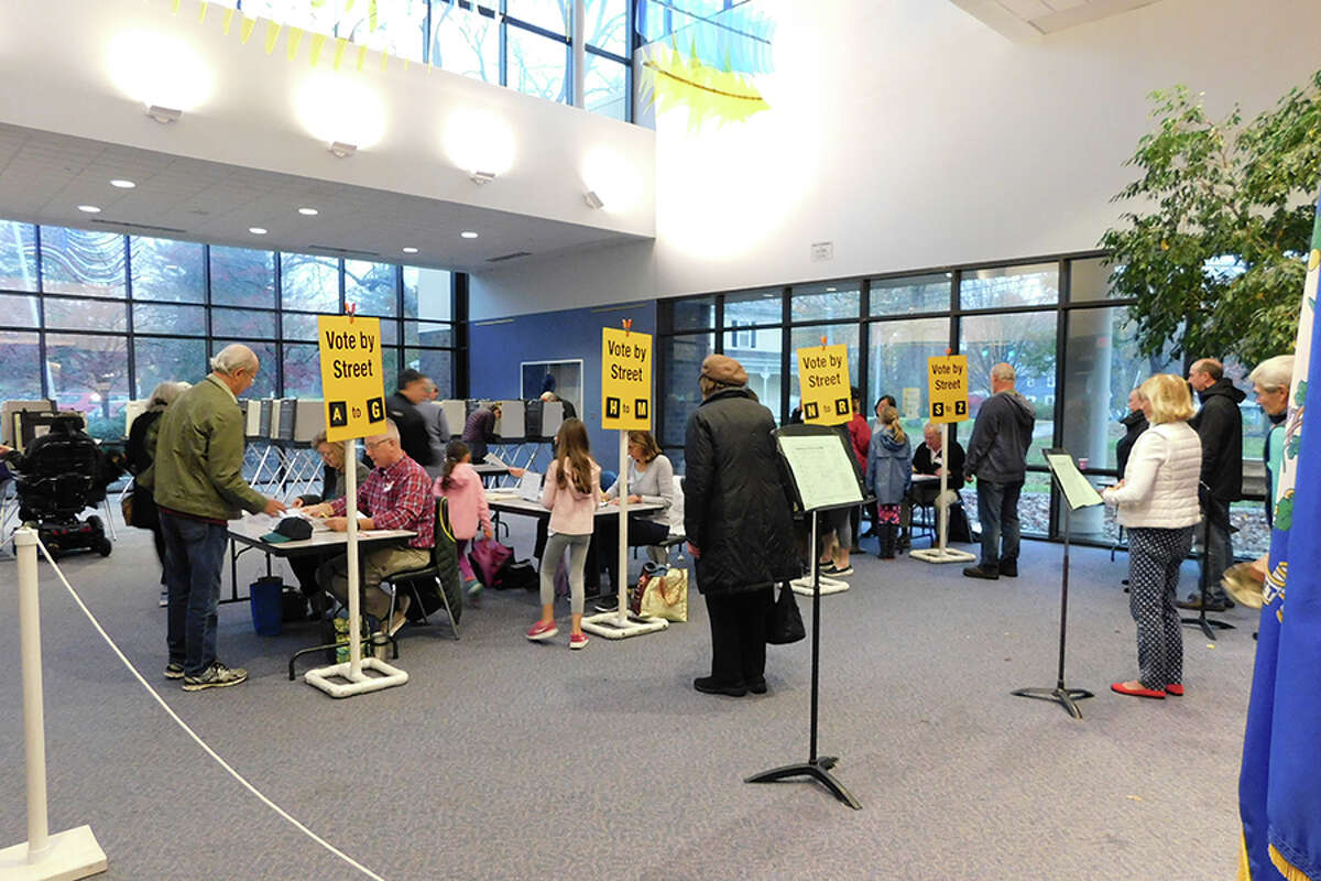 Voters line up at the Clune Center on Election Day. - Kendra Baker photo