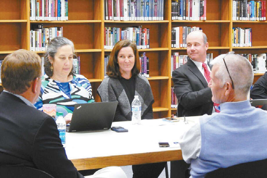 Middlebrook Principal Lauren Feltz, recently elected and soon-to-be Board of Education member Gretchen Jeanes and Wilton High School Principal Bob O'Donnell at a community conversation last year. — Kendra Baker photo