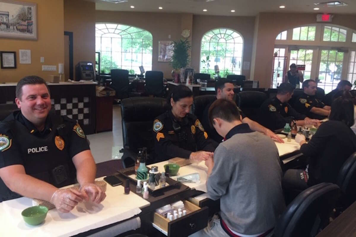 Wilton police get their nails painted purple in recognition of October as Domestic Violence Awareness Month.