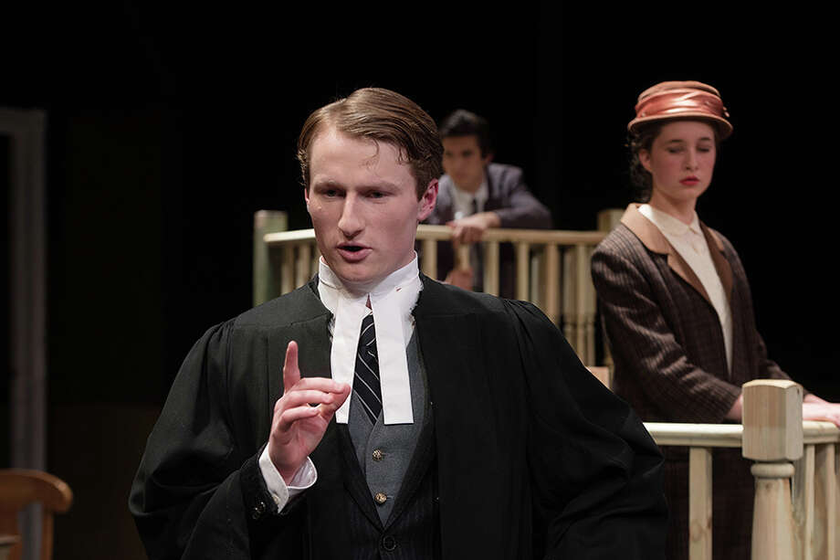 Sir Wilfred Robarts (Nicholas Furst) questions Janet MacKenzie (Olivia Vitarelli), devoted housekeeper of the victim while Leonard Vole (Andrew Tsantilas), the accused looks on. / BryanHaeffele