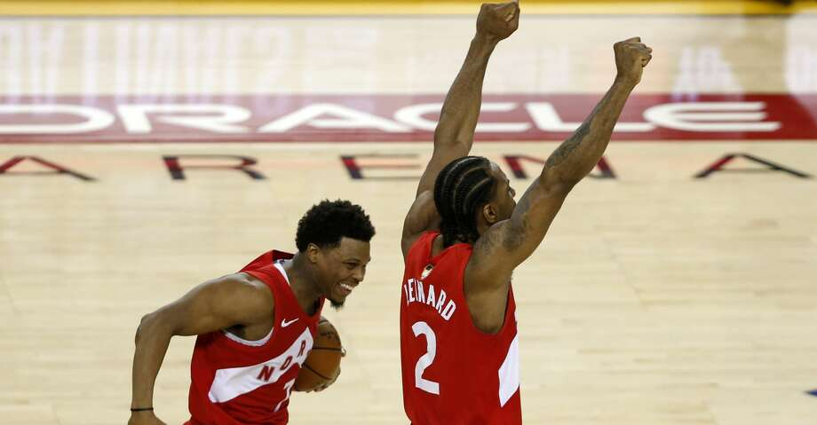OAKLAND, CALIFORNIA - JUNE 13:  Kyle Lowry #7 and Kawhi Leonard #2 of the Toronto Raptors celebrates his teams win over the Golden State Warriors in Game Six to win the 2019 NBA Finals at ORACLE Arena on June 13, 2019 in Oakland, California. NOTE TO USER: User expressly acknowledges and agrees that, by downloading and or using this photograph, User is consenting to the terms and conditions of the Getty Images License Agreement. (Photo by Lachlan Cunningham/Getty Images) Photo: Lachlan Cunningham/Getty Images