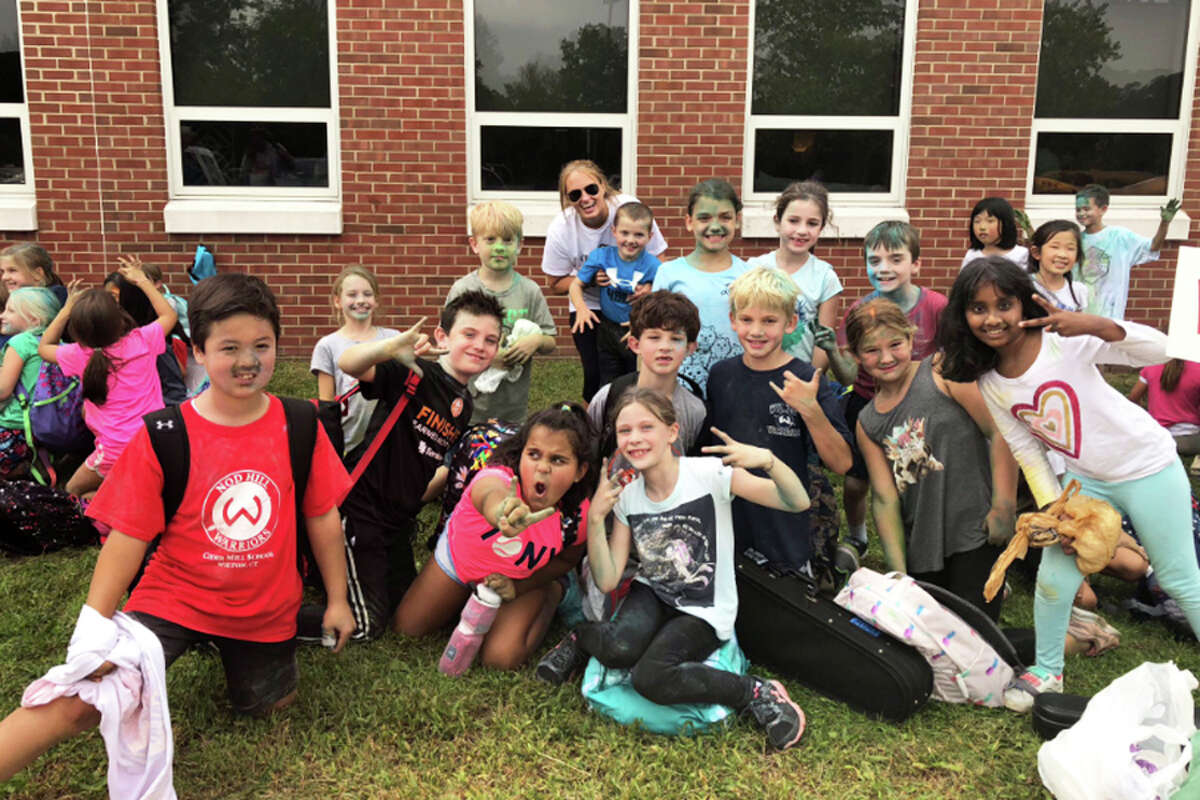 Cider Mill students celebrate with third grade teacher Emily Mason after walking the Cider Mill Walkathon on Oct. 4. - Contributed photo