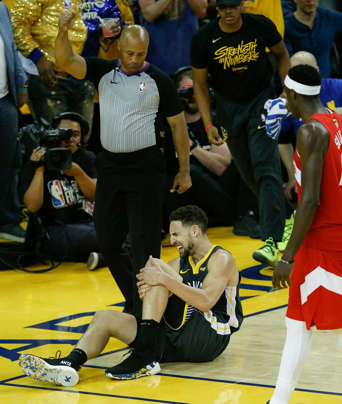 Golden State Warriors' Klay Thompson holds his leg in pain in the third quarter during game 6 of the NBA Finals between the Golden State Warriors and the Toronto Raptors at Oracle Arena on Thursday, June 13, 2019 in Oakland, Calif.