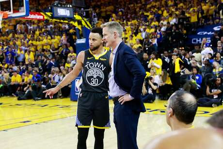 Stephen Curry (30) speaks with coach Steve Kerr during the first half of Game 6 of the NBA Finals between the Golden State Warriors and the Toronto Raptors in Oakland, California, on Thursday, June 13, 2019.