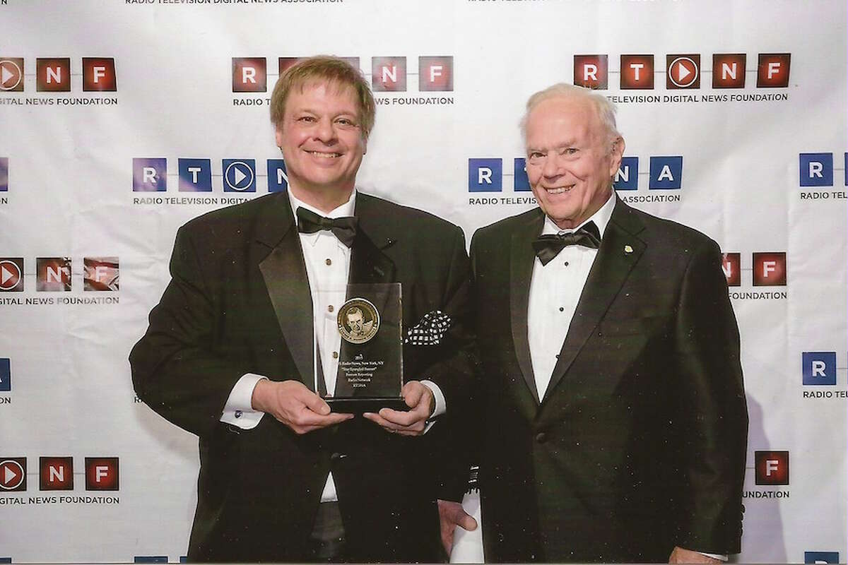 Dave Barrett is joined by his father, Nelson Barrett, when Dave won the Edward R. Murrow Award in 2015. - Contributed photo