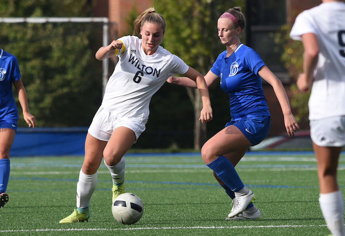 Lindsay Groves dribbles past a Darien player during Thursday's game. - Dave Stewart photo
