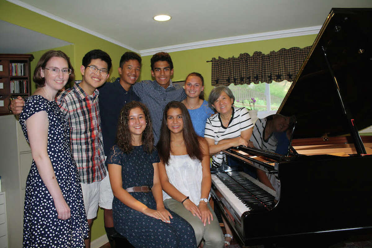 Performing in the Playing by Heart benefit concert are, standing from left, Sharon Kesselman, Woongki Hong, Colin Hong, Jack Nanez, and Peyton Lauricella, students of Kyong Hee Cho. Seated are Alisyn Kercher and Claudia Nanez. Missing from photo is student Martha West-Glynn.