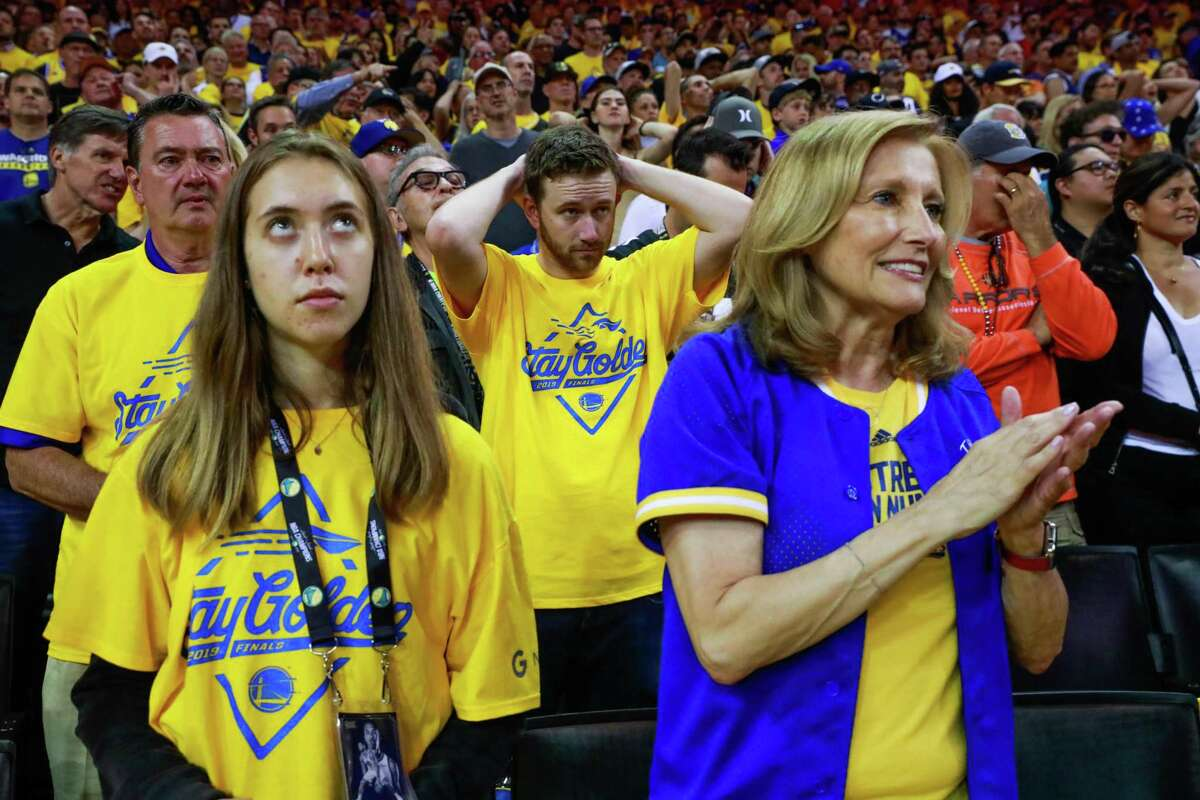 Fans anxiously watch the first half of Game 6 at Oracle Arena.