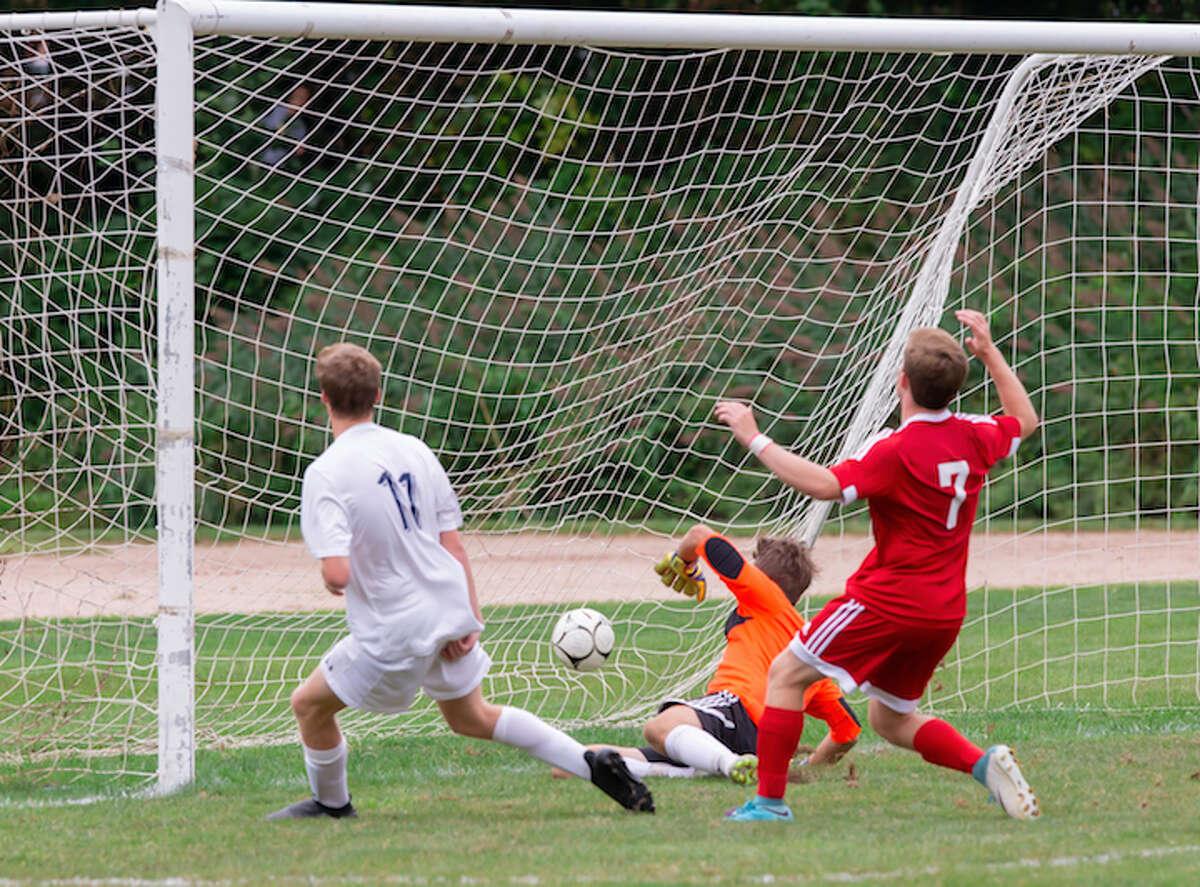 Luke Macdonald deposits Wilton's second goal into the New Canaan net. - GretchenMcMahonPhotography.com