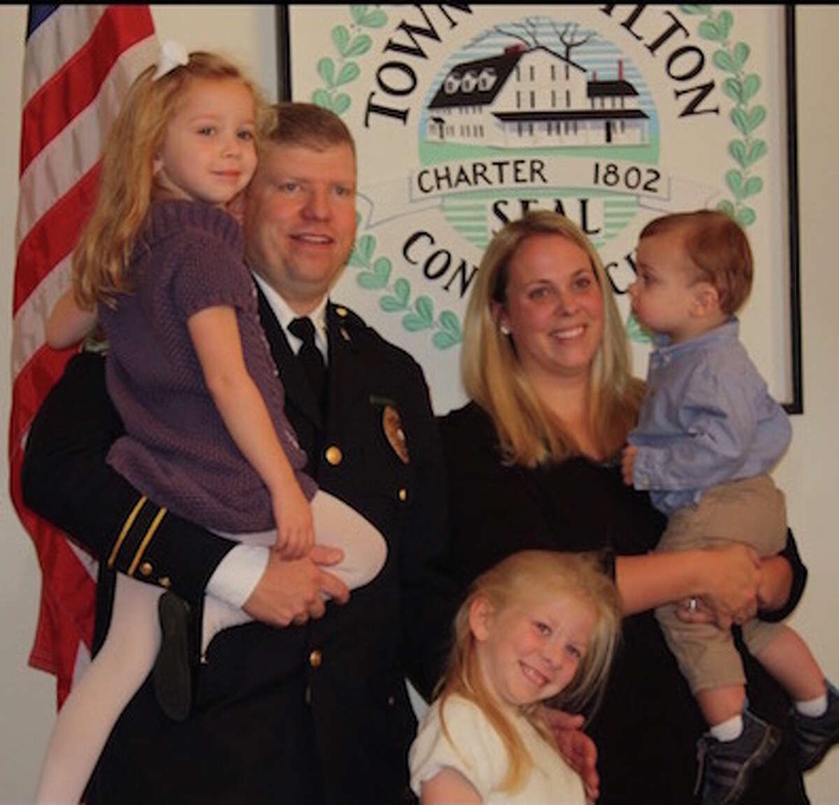 Capt. Thomas Conlan at his promotion in 2015 with wife Ashley, son Jake, and daughters Kaitlyn and Bryn. - Contributed photo