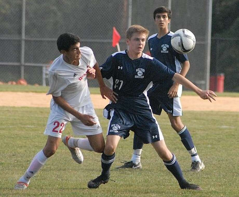 Matt Newfield (right) is one of only seven seniors on this year's Wilton boys soccer team. — J.B. Cozens photo