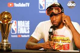 OAKLAND, CALIFORNIA - JUNE 13: Kawhi Leonard #2 of the Toronto Raptors speaks with the media following his teams victory over the Golden State Warriors to winGame Six of the 2019 NBA Finals at ORACLE Arena on June 13, 2019 in Oakland, California. NOTE TO USER: User expressly acknowledges and agrees that, by downloading and or using this photograph, User is consenting to the terms and conditions of the Getty Images License Agreement. (Photo by Thearon W. Henderson/Getty Images)