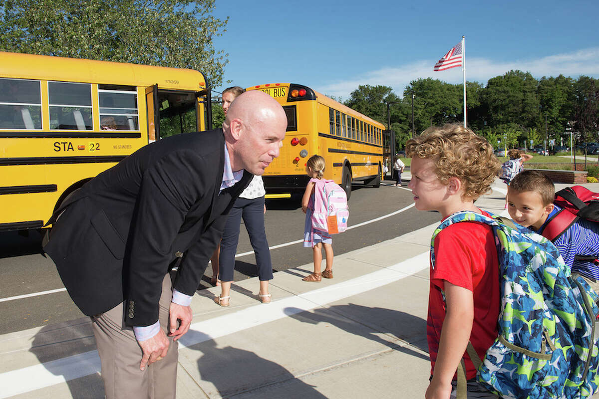 Assistant Principal Jeremy Cross talks with first grader Sam Thompson.