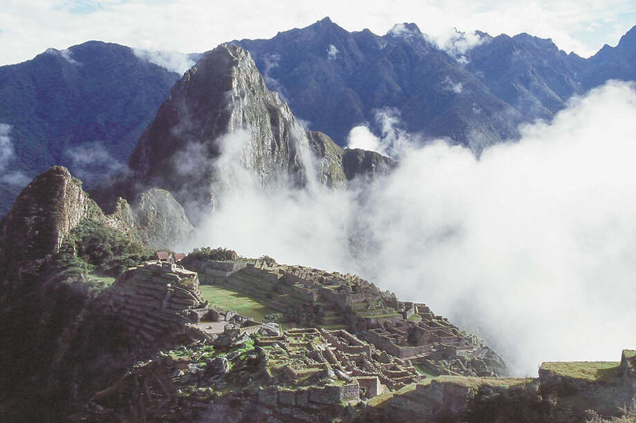 Ruins are surrounded by clouds in Machu Picchu, Peru.