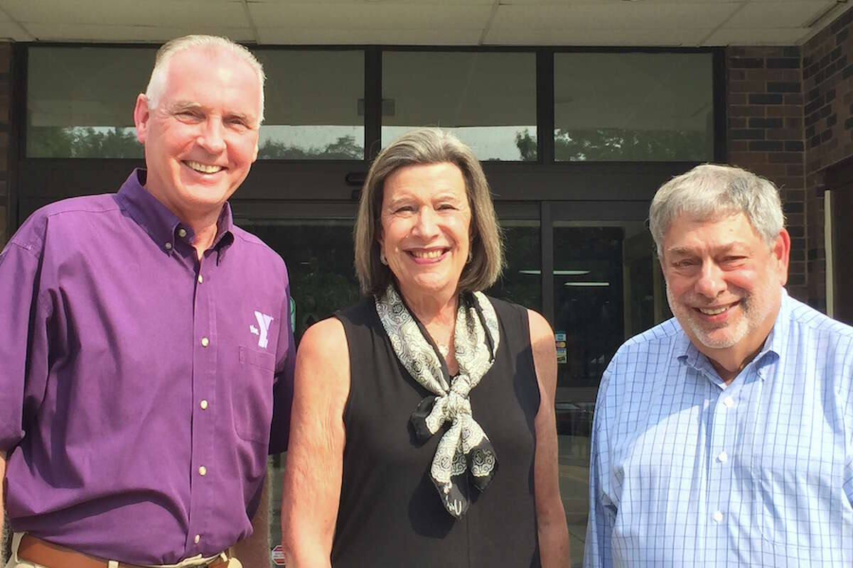 YMCA CEO Robert McDowell, left, joins this year's Distinguished Citizens Dr. Susan Weinberger of Norwalk and Dick Dubow of Wilton. - Contributed photo