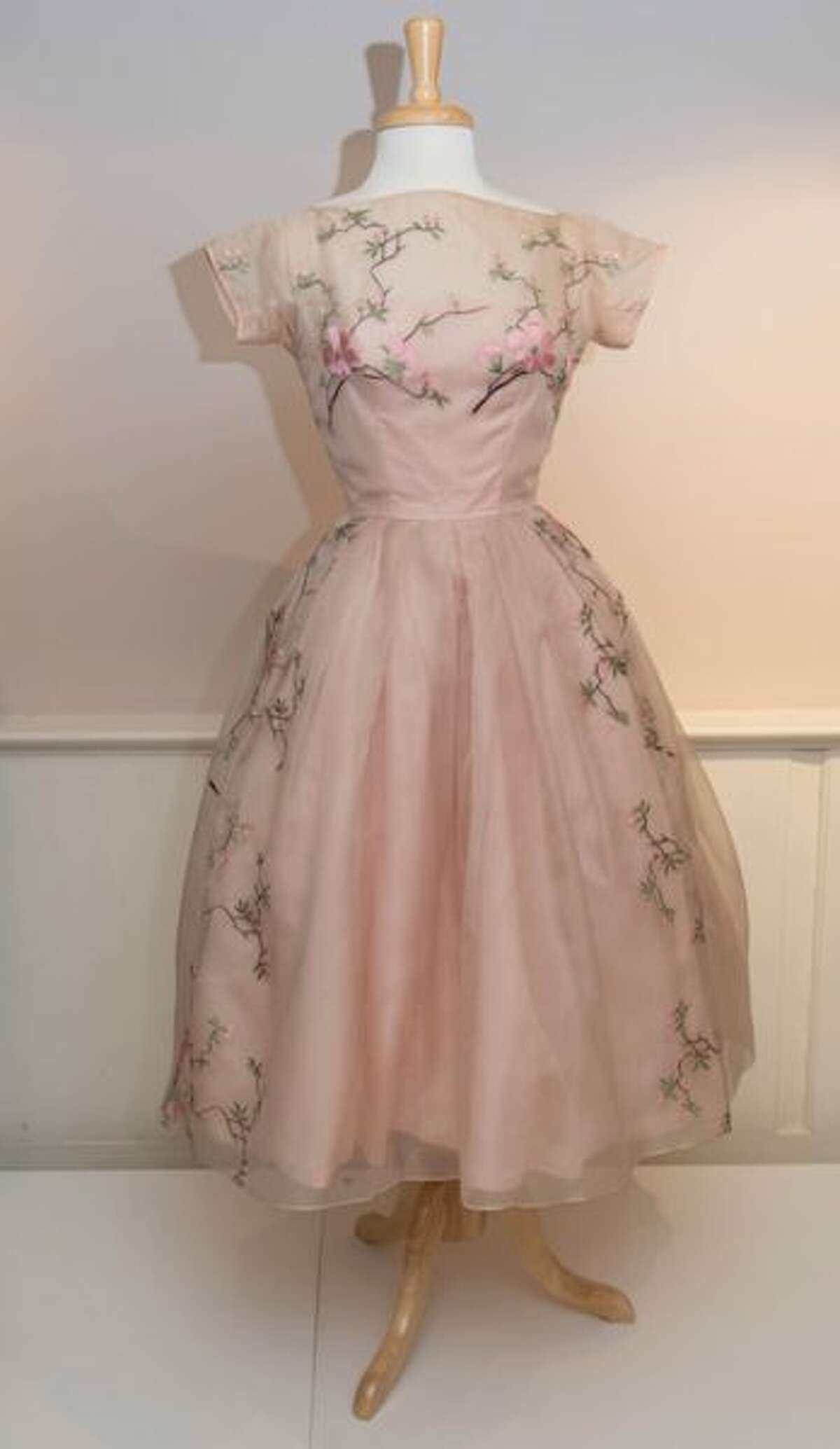 """A pink dress from the 1950s-60s, inspired by Christian Dior's """"New Look."""""""