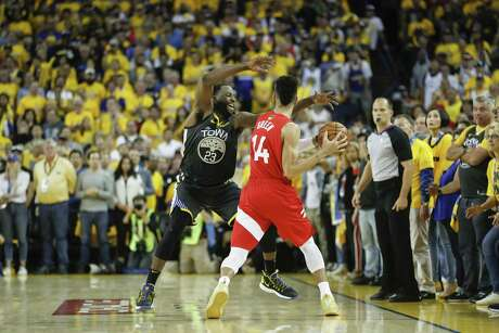 Golden State Warriors' Draymond Green defends against Toronto Raptors' Danny Green in the fourth quarter during game 6 of the NBA Finals between the Golden State Warriors and the Toronto Raptors at Oracle Arena on Thursday, June 13, 2019 in Oakland, Calif.