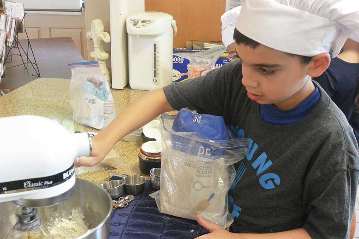 Liam Gallary, 9, of Wilton, mixes up some cookie dough at healthy Kids Cooking Camp. -Tony Spinelli photo
