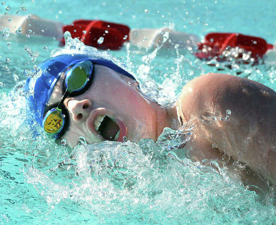 Lucas Frye of Summers Port swims the 13-14 boys 200-meter freestyle in Thursday night's season opener against Montclaire in Edwardsville. Frye finished second. Photo: Scott Marion | For The Telegraph