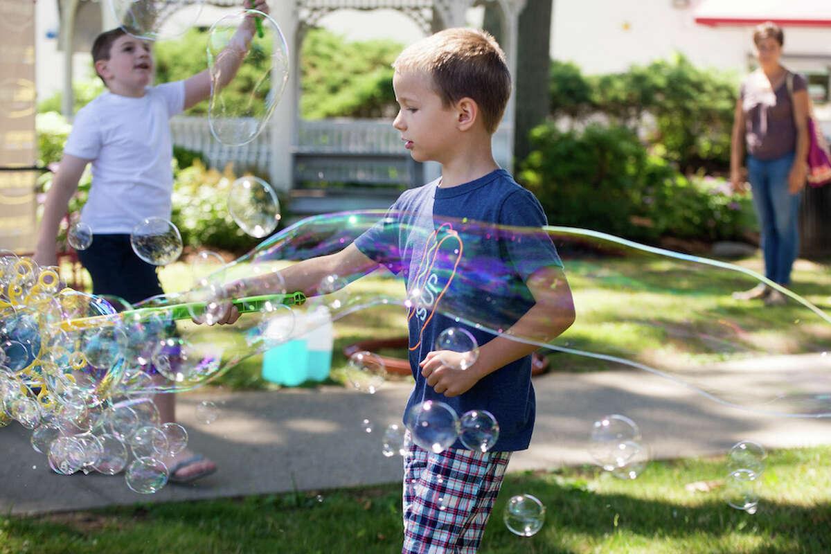 Noah Thorton has fun with bubbles. - Bryan Haeffele photo
