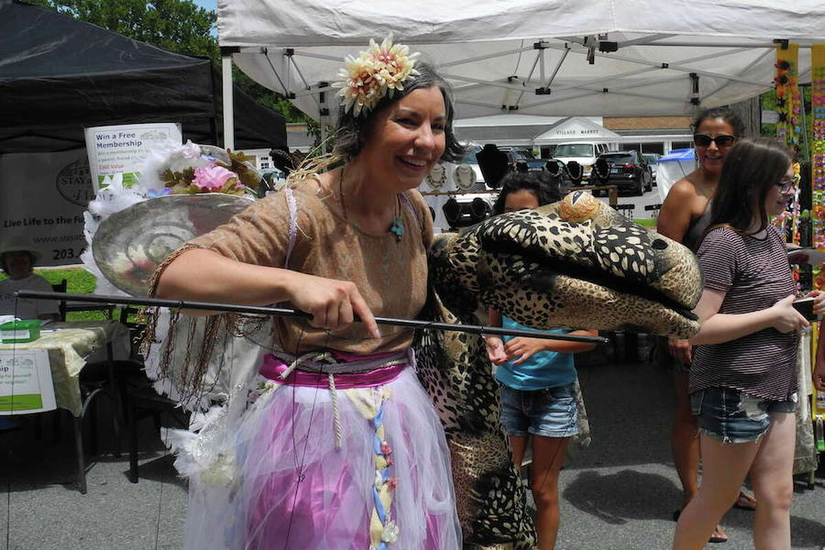 Adelka Polak of Sava Dance and Puppet Theater entertains the crowds. - Jeannette Ross photo