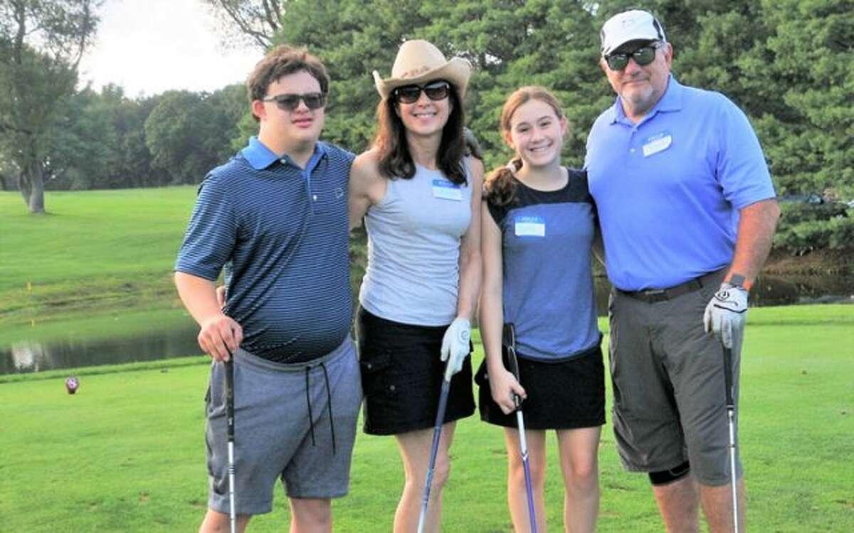 Family enjoying STAR's benefit Golf Tournament.