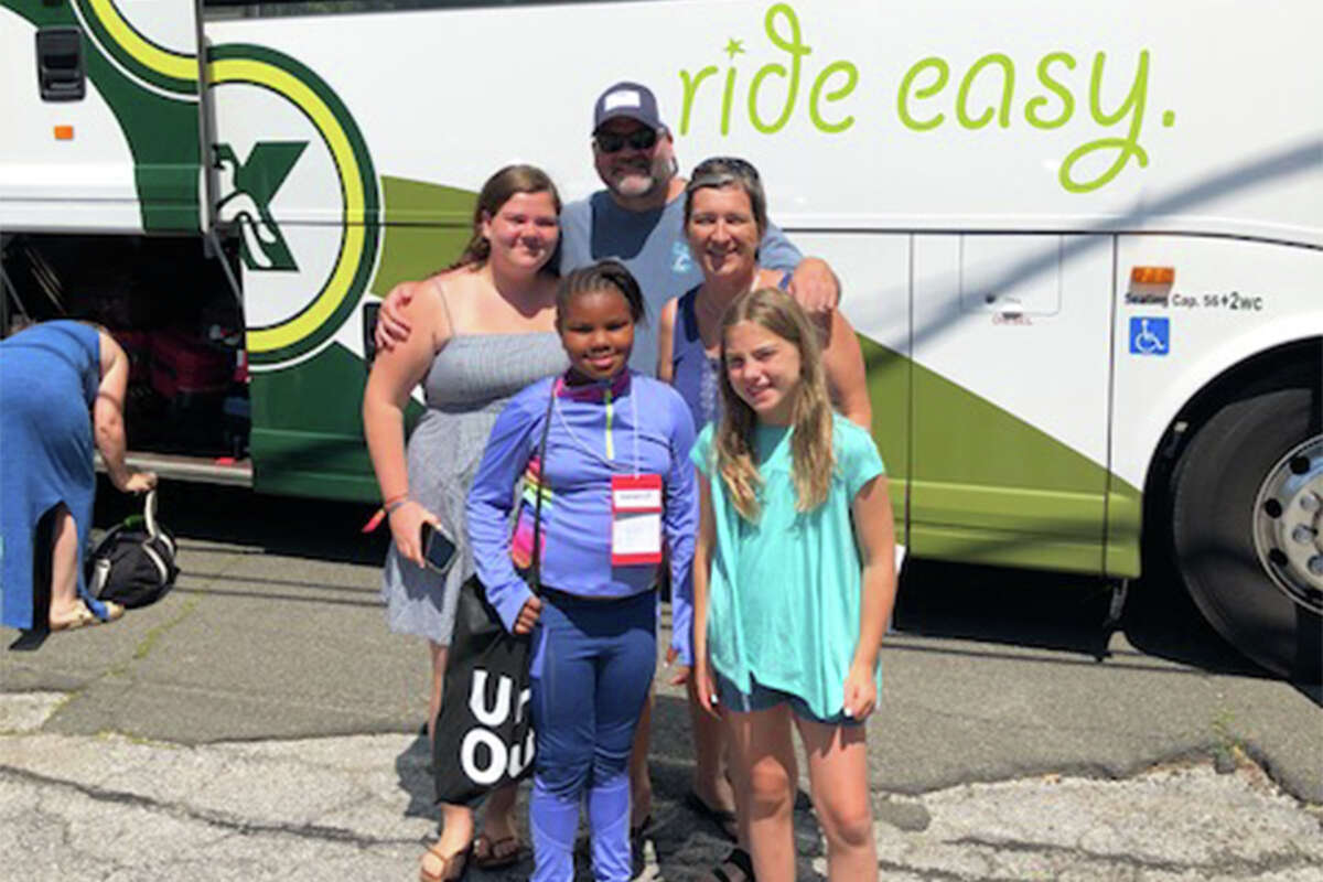 The Elias family picks up Savannah from Darien on June 28.
