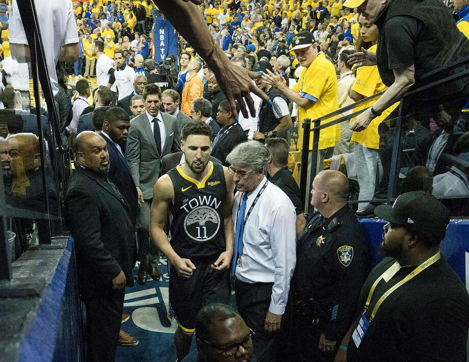 Golden State Warriors' Klay Thompson leaves the game in the third quarter after sustaining a leg injury during game 6 of the NBA Finals between the Golden State Warriors and the Toronto Raptors at Oracle Arena on Thursday, June 13, 2019 in Oakland, Calif. Photo: Carlos Avila Gonzalez, The Chronicle
