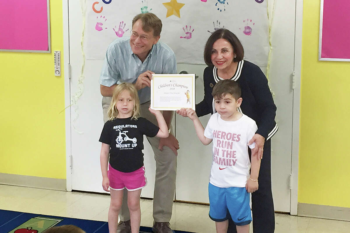 Connecticut Early Childhood Alliance Director Merrill Gay, left, presents state Sen. Toni Boucher, right, with the Children's Champion Award at the Riverbrook Regional YMCA.