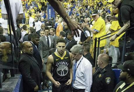 Golden State Warriors' Klay Thompson leaves the game in the third quarter after sustaining a leg injury during game 6 of the NBA Finals between the Golden State Warriors and the Toronto Raptors at Oracle Arena on Thursday, June 13, 2019 in Oakland, Calif.