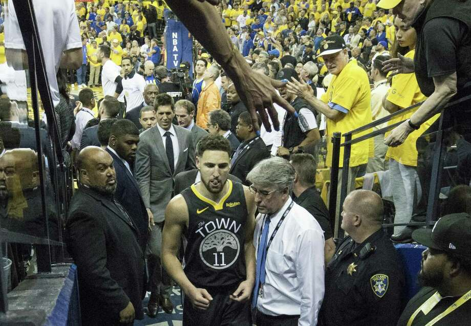 Golden State Warriors' Klay Thompson leaves the game in the third quarter after sustaining a leg injury during game 6 of the NBA Finals between the Golden State Warriors and the Toronto Raptors at Oracle Arena on Thursday, June 13, 2019 in Oakland, Calif. Photo: Carlos Avila Gonzalez / The Chronicle / online_yes