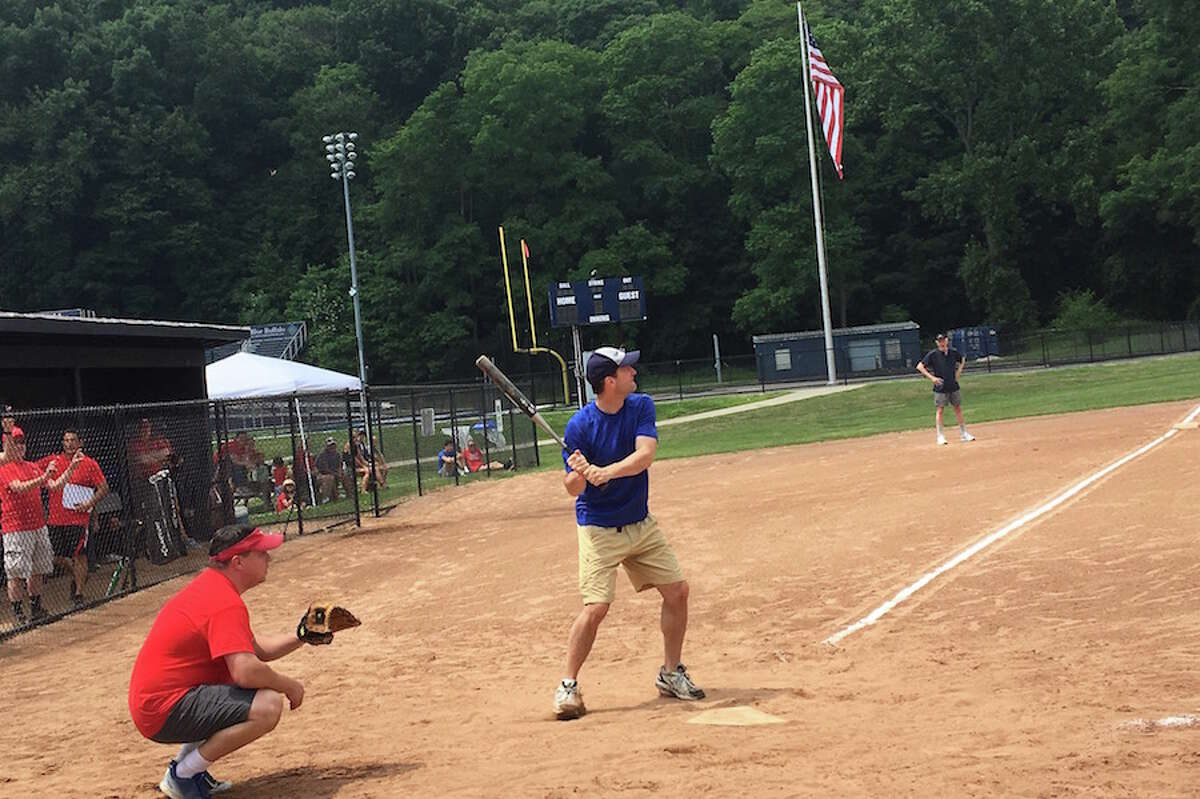 Congressman Jim Himes takes a turn at bat. - Contributed photo