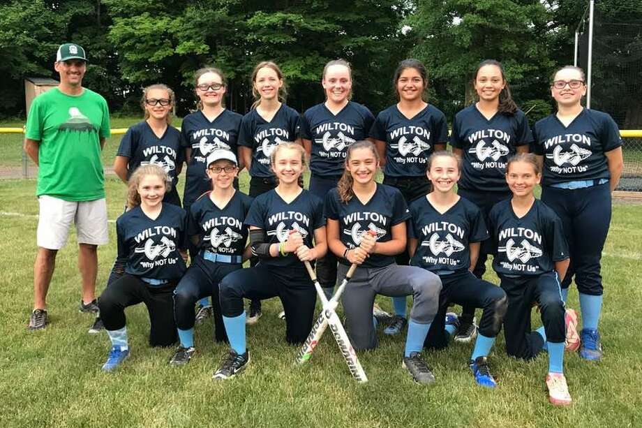 The Wilton Little League 12U all-star softball team includes, from the left, front row: Katherine Costanzo, Amelia Fleming, Ally van Heyst (captain), Avery Samai (captain), Marin Burke and Sadie Klyver; and back row: coach Todd Klyver, Kelcie Petrone, Avery Schestag, Anna Joy, Ella Christ, Lauren Davis, Riya Shah and Dana Pettersen. Missing are manager Dirk van Heyst and coach Amanda Samai.