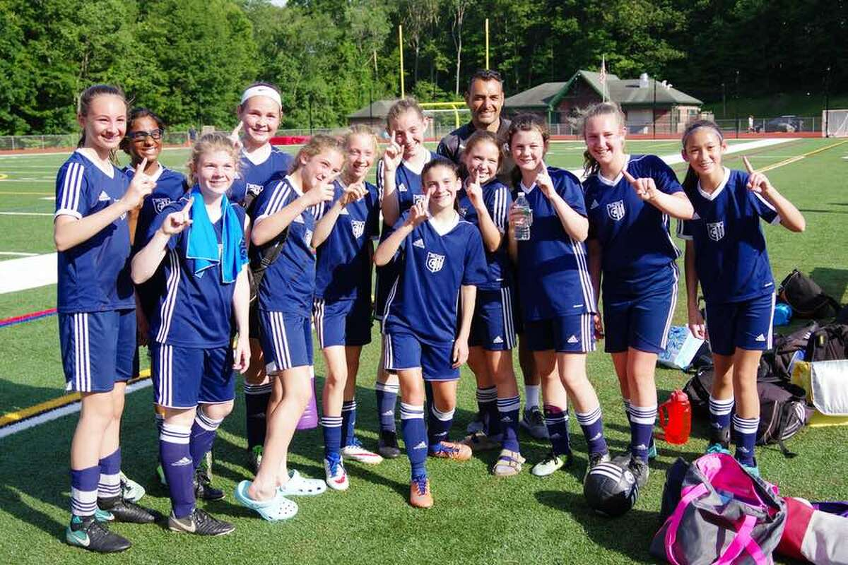 The Wilton Blue U13 girls travel soccer team celebrates its division-clinching win over Monroe on June 17.