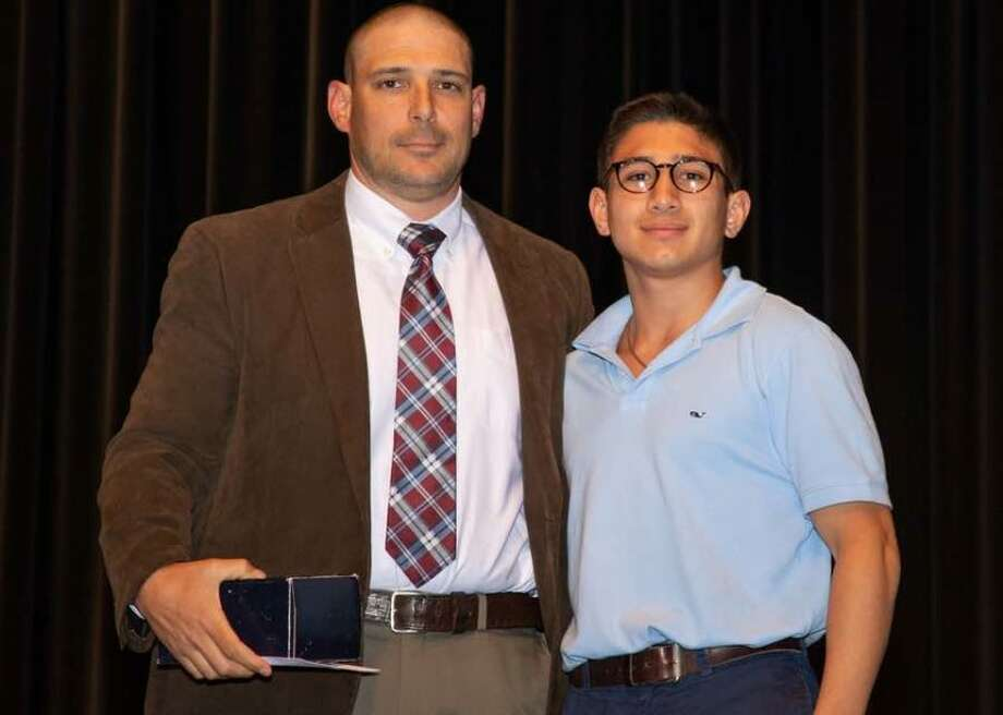 Outgoing Wilton High wrestling coach John Foldeak with Nick Rende as the recent Wilton High School Senior Sports Awards Night. — GretchenMcMahonPhotography.com