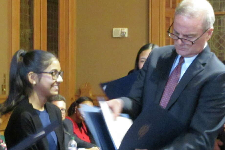 Ria Raniwala receives an award for her presentation at the Oral Kids Court Competition in Hartford on June 12. — Contributed photo