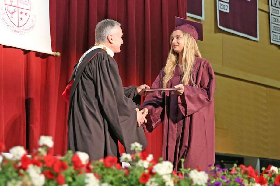 Sydney Adamsen receives her diploma from Head of School Mark Davis, center. — Contributed photo