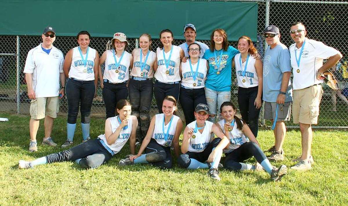 The Wilton 14U girls softball team after winning the Pomperaug tournament last Sunday. From the left, front row: Caitlin Wallace, Samantha Nilsen, Adriana Annese and Jenna Geaney; and back row: coach Mike Wallace, Dakota Kelly, Lauren Mellas, Brooke Bohacs, Elizabeth Butler, coach Anthony Andre, Molly DeLuca, Rebecca Adam, Annabella Andre, coach Mark Bohacs and coach John Kelly. Missing are Christina Sinatra, Kaylee Drago, Nicole Spinelli and head coach Andrea Sidor.