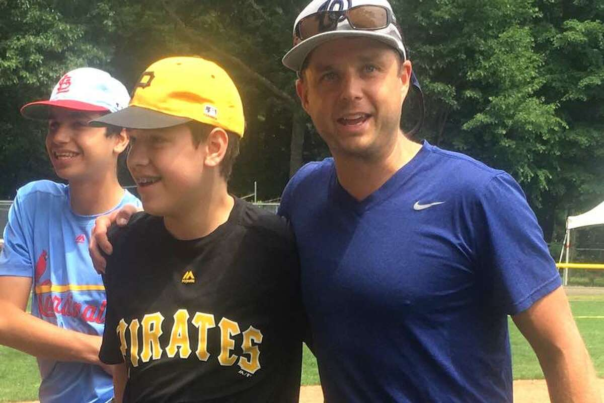 Max Jarvie won the annual Wilton Little League Home Run Derby on June 9. He is shown here with WLL coach Jeff Szymanowicz, who handled pitching duties at the event.