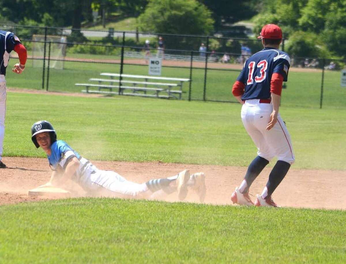Chris Tienken slides safely into second base during the Wilton American Legion Post 86 Senior baseball team's home game last Saturday. - J.B. Cozens photo