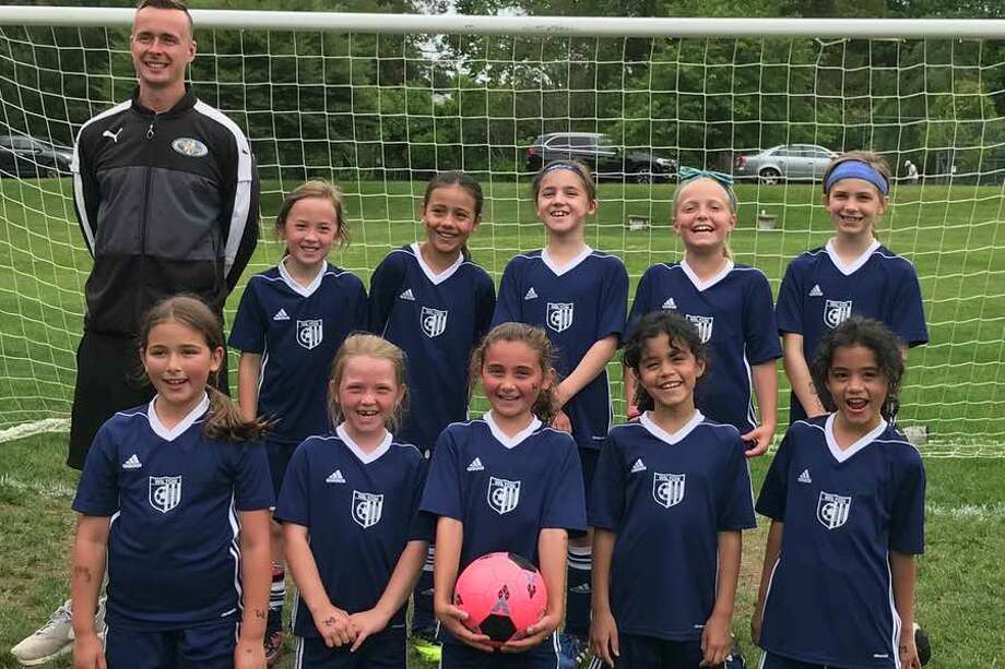The Wilton White U-9 girls soccer team, from left to right, front: Ashley Pencu, Grayson O'Donnell, Abigail Philippon, Isabella Rios and Sofia Rios; and back: coach Matt Jessup, Gabriella Ray, Gabriela Torres, Mia Timnev, Liesel Schmauch and Harper Crawford.
