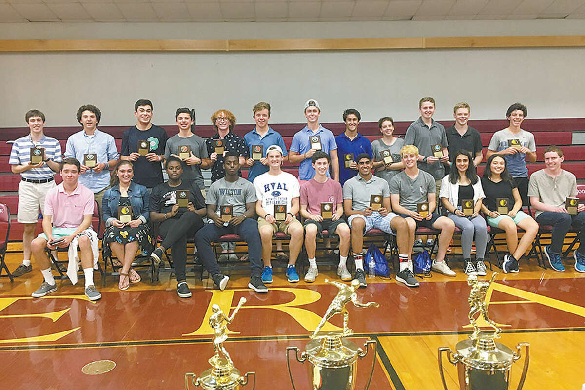 Alix Wadehra, third from right in the front row, and Libby Hinshaw, fourth from right in the back row, with the 21 other Wooster students honored at Wooster School's Upper School Spring Sports Season Celebration.